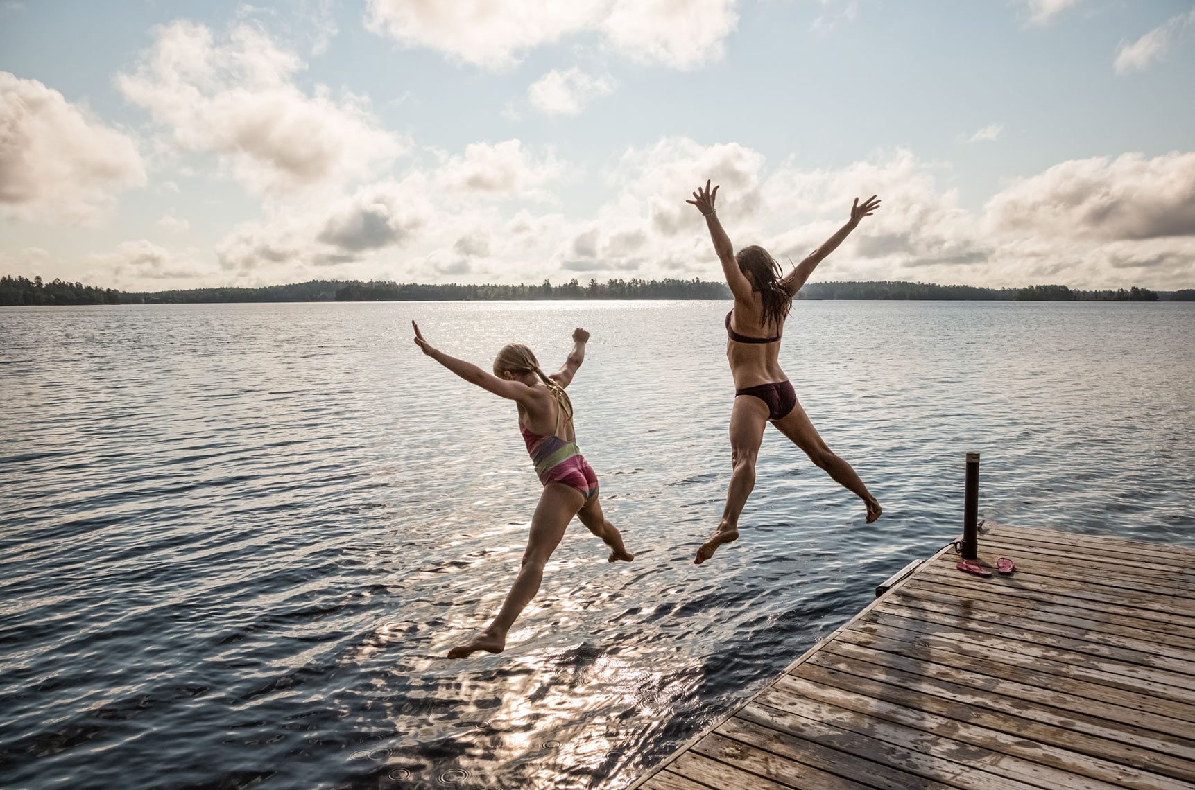 MOTHER-AND-A-DAUGHTER-JUMPING-OFF-A-DOCK