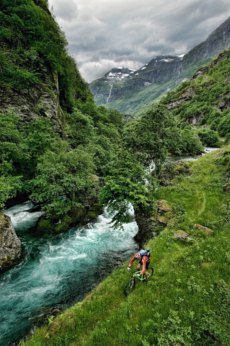 MOUNTAIN BIKER AND GLACIER RIVER