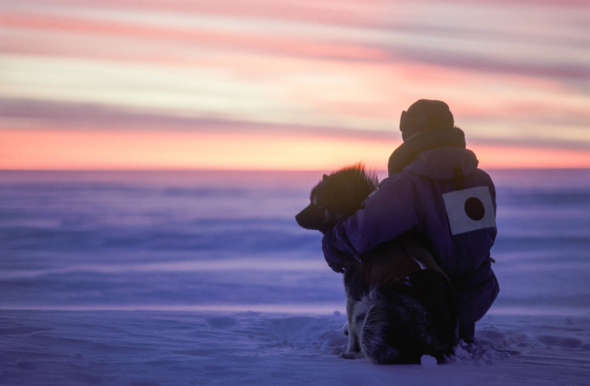 Trans-Antarctica-Expedition-Keizo-and-Odin-taking-in-the-sunset