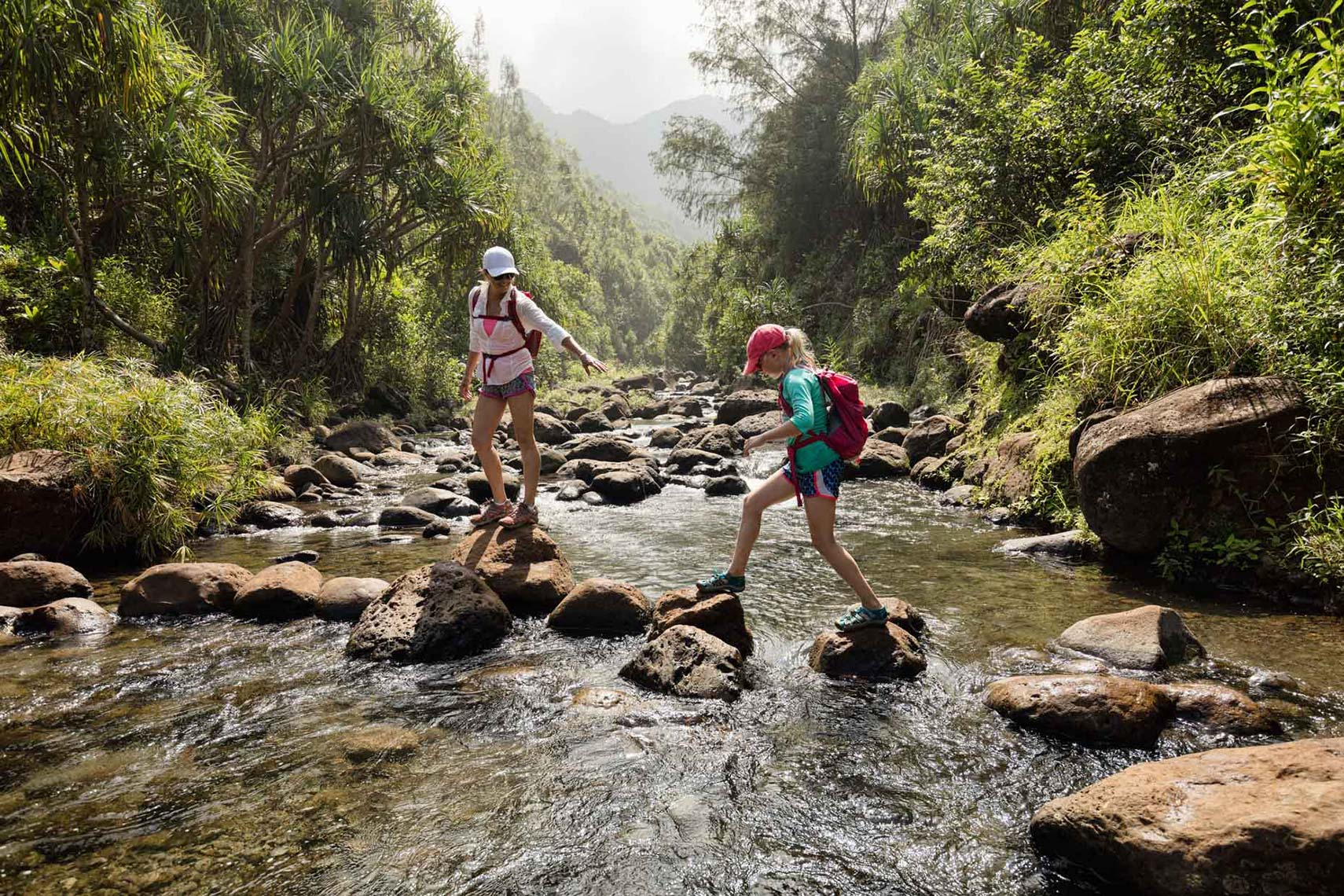 mother-and-daughter-crossing-a-creek_Na-Pali-Coast_Kauai_Hawaii